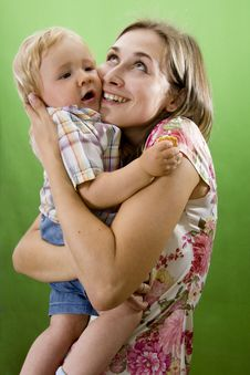 Free Mother And  Son Isolated On Green. Royalty Free Stock Photos - 23011068
