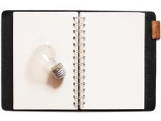 Free Light Bulb Placed On Notebook Stock Photos - 23016993