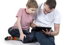 Free Father And Son With The Computer. Stock Image - 23022541