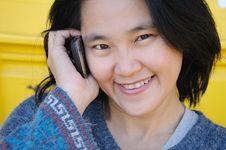 Free Asian Woman Talking On Mobile Phone Stock Photo - 23022560