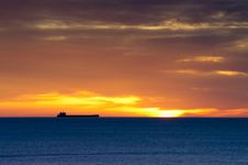 Free Cargo Ship On Horizon At Dawn Stock Image - 23024841