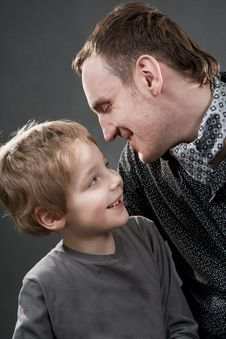 Free Father And Son Cheerfully Talk. Royalty Free Stock Photography - 23026997