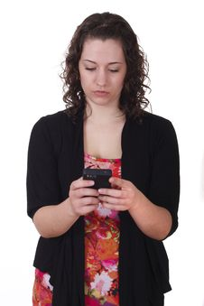 Young Brunette Using Smart Phone Royalty Free Stock Photos