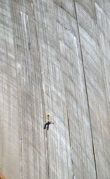 Bungee Jumper Against The Wall Of Dam. Royalty Free Stock Image