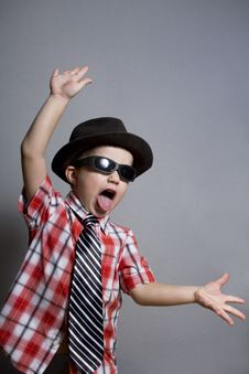 Free The Boy In A Hat And Black Glasses Royalty Free Stock Image - 23028896