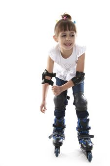 Free The Little Girl On Roller Skates Stock Photo - 23029850