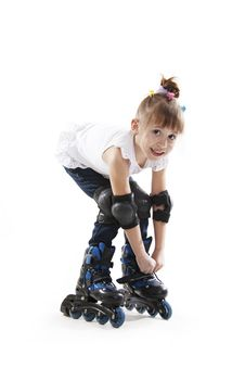Free The Little Girl On Roller Skates Royalty Free Stock Image - 23029866