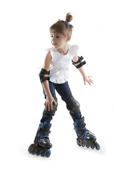 Free The Little Girl On Roller Skates Royalty Free Stock Photos - 23029898