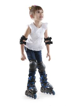 Free The Little Girl On Roller Skates Royalty Free Stock Photos - 23029928