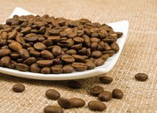 Free Grains Of Coffee Lie On A Saucer Stock Photos - 23034553