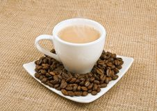 Free Coffee And Milk And Saucer With Grains Stock Photography - 23034582