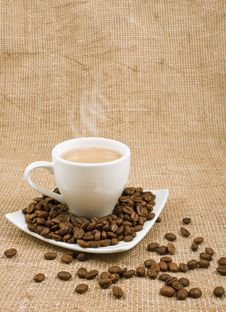 Free Coffee And Milk And Saucer With Grains Royalty Free Stock Photo - 23034615