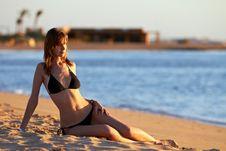 Free Young Woman In Bikini Posing On Sea Coast Stock Photography - 23036892