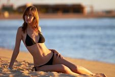 Young Woman In Bikini Posing On Sea Coast Stock Image