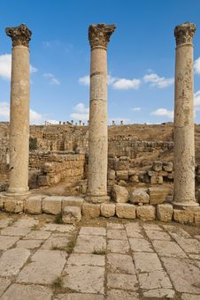 Free Three Columns Along The Roman Road In Jerash Royalty Free Stock Image - 23039846