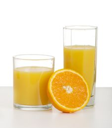 Two Glasses Of Orange Juice And Sliced Ripe Orange Royalty Free Stock Photo