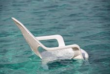 Free White Plastic Beach Chair In Sea Stock Photo - 23055510