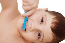 Smiling Boy Cleaning His Teeth Stock Photography