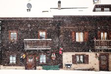 Free Snowing In Front Of Traditional House Stock Photo - 23060440