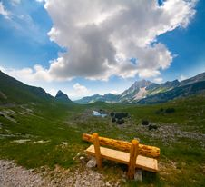 Free Solitary Bench  On Alps Valley Stock Photos - 23064043