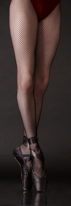 Ballerina S Legs On Pointe In Fishnet Tights Stock Image