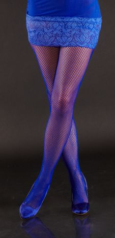 Free Woman S Legs In Blue Fishnet Pantyhose Royalty Free Stock Photography - 23066017