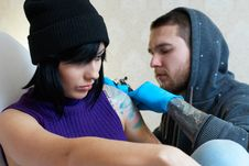 Emotions Of A Girl While Making A Tattoo Stock Photography