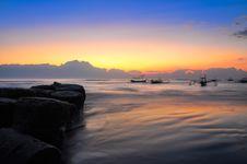 Free Ocean Coast Sunrise And Blury Boats Stock Photos - 23076213