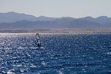 Free Silhouette Of A Windsurfer Stock Photo - 23077520