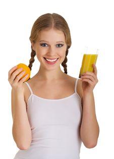 Beautiful Girl Full Of Life With Orange Juice Royalty Free Stock Image