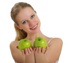Free Healthy Girl Holding A Two Green Apple Stock Photography - 23082412