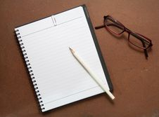 Free New Black Notebook With White Pencil And Glasses Royalty Free Stock Photos - 23090008