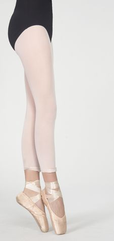 Ballerina S Legs On Pointe In White Tights Royalty Free Stock Photography