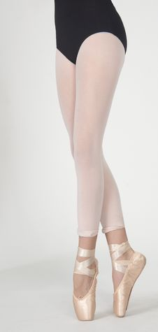 Ballerina S Legs On Pointe In White Tights Royalty Free Stock Image