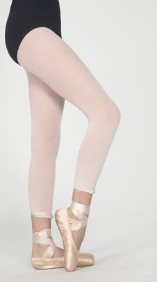 Ballerina S Legs On Pointe In White Tights Stock Images