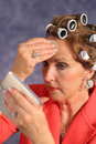 Free Woman With Rollers Applying Po Stock Image - 2310931