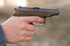 Man S Hand And A Gun Stock Images