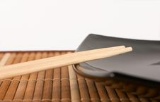 Free Chopsticks On The Black Plate Royalty Free Stock Photos - 2314928