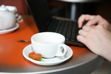 Free Cap Of Tea And Netbook Stock Image - 23100631