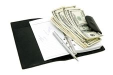 Free Notebook And Dollars Stock Photography - 23111822