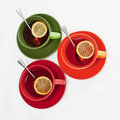 Free Three Colored Tea Cups Royalty Free Stock Photography - 23129177