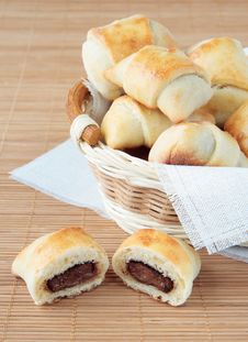 A Basket Of Rolls With Chocolate Stock Photos