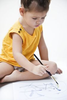 Free Girl Draws A Picture Paints Stock Photos - 23136063