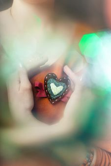 Free Heart-shaped Brooch With Bokeh Royalty Free Stock Photography - 23137077
