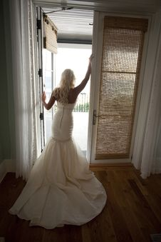 Bride In Front Of An Open Door Stock Image