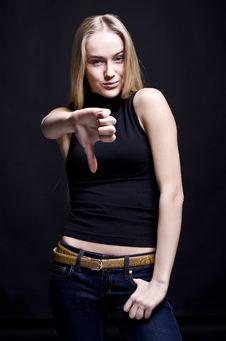 Girl With Thumbs Down Stock Photos