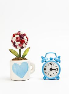 Blue Cup Wiht Heart Symbol And Blue Alarm Clock Royalty Free Stock Photos