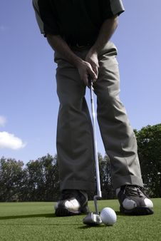 Free Golfer Sets Up For A Putt Royalty Free Stock Photo - 23162955