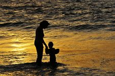 Mother And Child At Dusk Stock Photos