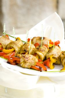 Roll Meat With Yellow And Red Peppers Stock Photos